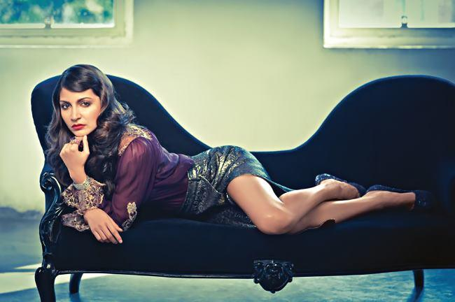 Anushka Completed Her Look With Flowing Hair On Sofa Still For Harper's Bazaar Mgazine