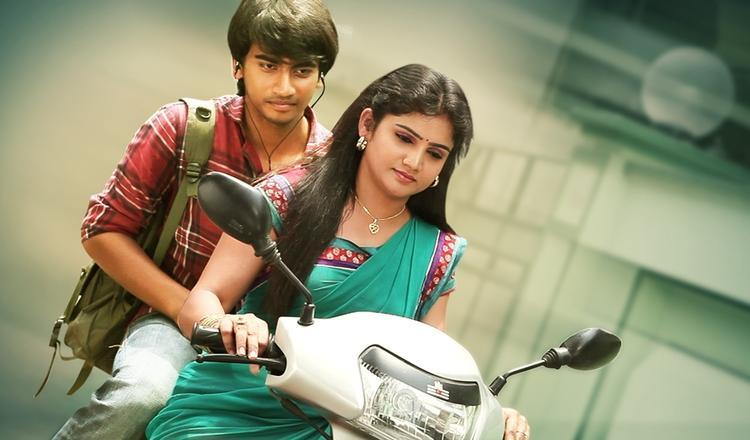 Krishna And Hasini Scooter Riding Still From Telisi Teliyaka Movie