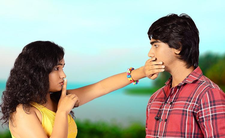 Maithili And Krishna A Still From Telisi Teliyaka Movie