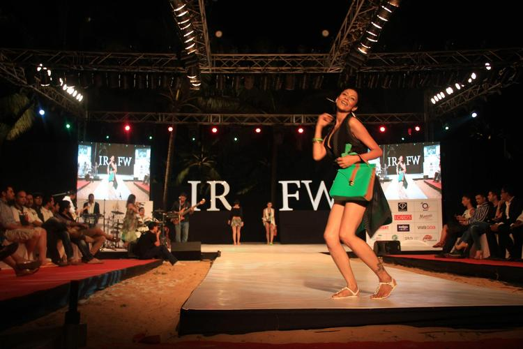 A Model Looking Hot In Black Mini Dress Walks For Gogee Vasant At India Resort Fashion Week 2012