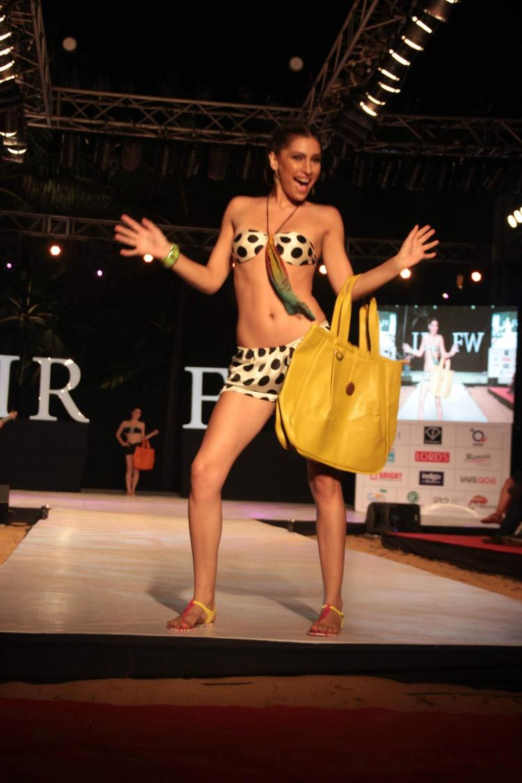 A Model In White And Black Color Patch Bikini On Ramp For Gogee Vasant At India Resort Fashion Week 2012