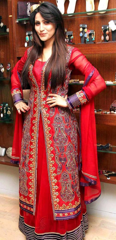 A Guest Looked Gorgeous In A Red Gown Posed At Aanchal Kumars New Collection Launch