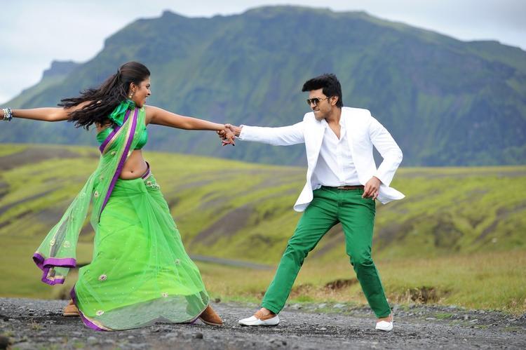 Ram Charan And Amala Dancing Pose Still From Nayak Movie