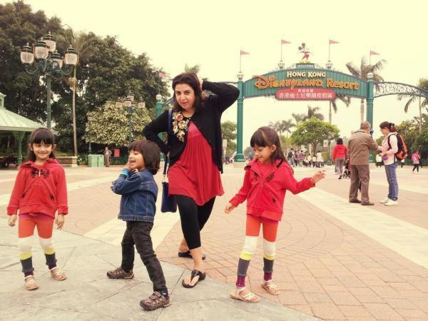 Farah Doing A Dance Step With Her Childrens In A Park Photo