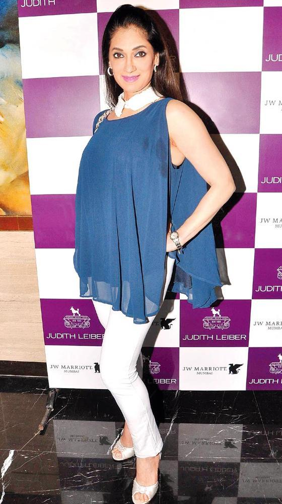 Lucky Gets The Blues At The Launch Of Judith Leiber New Collection Of Clutches