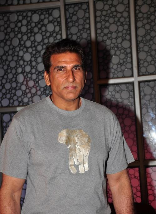 Mukesh Rishi Posed For Camera At The First Look Launch Of Rajdhani Express