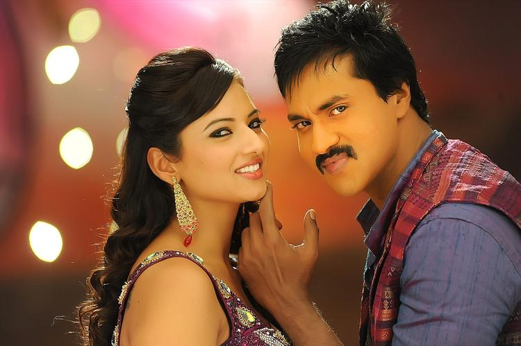Sunil And Isha Nice Look With Cute Smiling Still From Movie Mr Pellikoduku