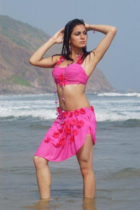 Shraddha Arya In Pink Mini Skirt Beach Still