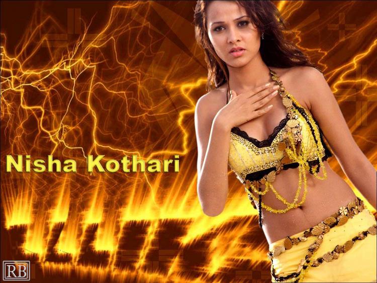 Nisha Kothari Sexy Still In Yellow Mini Skirt