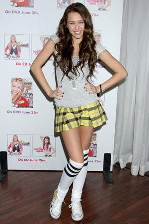 Miley Cyrus Cute Pose In Mini Skirt