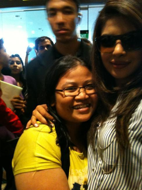 Priyanka Chopra With a Fan at Singapore International Airport