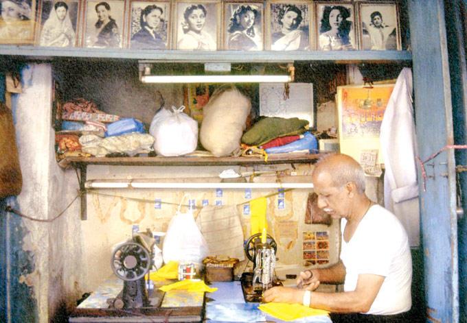 A Tailor Steaching Cloth Photo  In Kamathipura