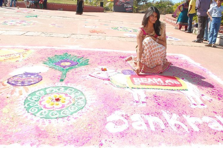 A Girl Posed In Making Rangoli At Radio Mirchi Sankranthi Sambaralu 2013