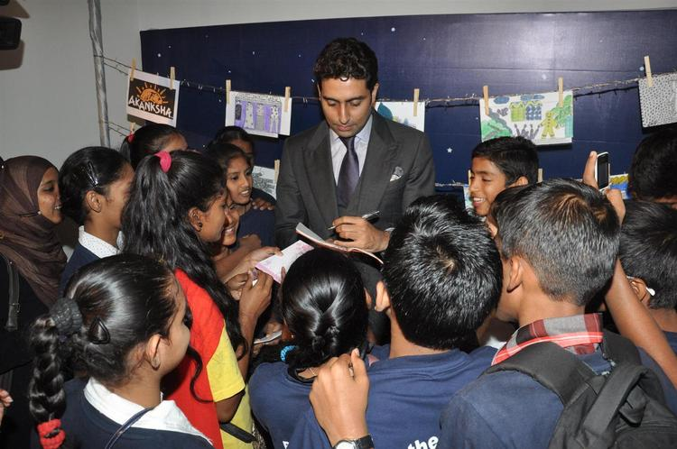 Abhishek Gives Autograph To The Children At Art Exhibition Of Radhika Goenka