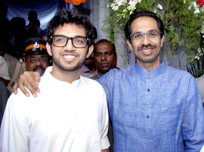 Uddhav And Son Aaditya Smiling Pose Photo Clicked At The Launch Of Virtual Studio
