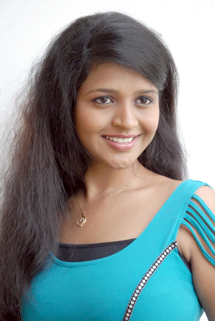 Aswi Cute Smiling Photo Still At Amma Nanna Voorelithe Movie Press Meet