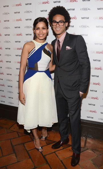 Freida Pinto Posed With A Friend At Pre-Oscar Bash 2013