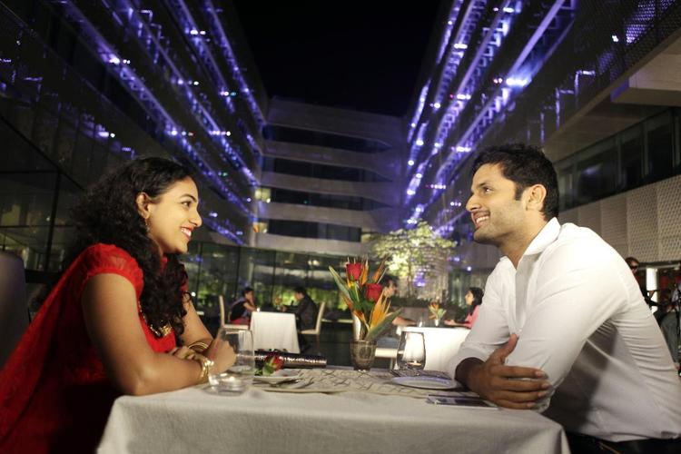 Nitin And Nithya Photo Still On Dinner Table From Movie Gunde Jaari Gallanthayyinde