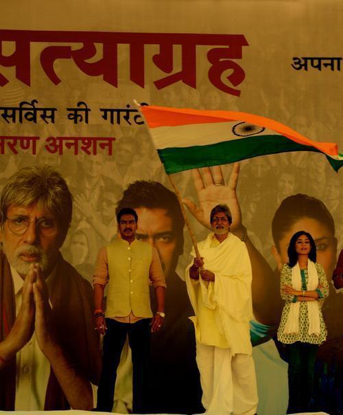 Amitabh,Ajay And Amrita With Flag On The Sets Of Satyagraha