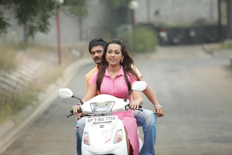 Sairam And Ester On Scooty Photo Still From Movie 1000 Abaddalu
