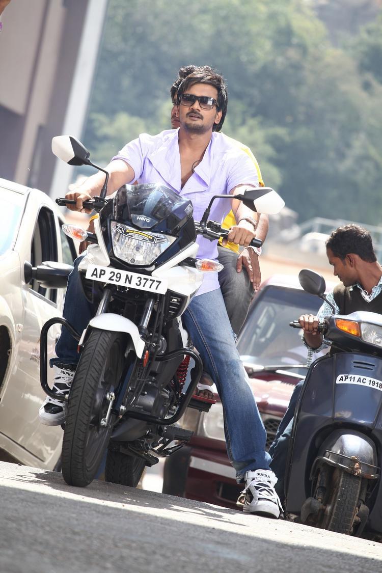 Sairam Stylish Look On Bike Photo Still From Movie 1000 Abaddalu