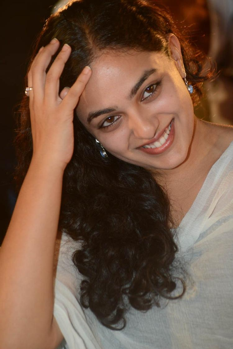 Nithya Menen Cute Smiling Look Still At Gunde Jaari Gallanthayyinde Movie Audio Release Function