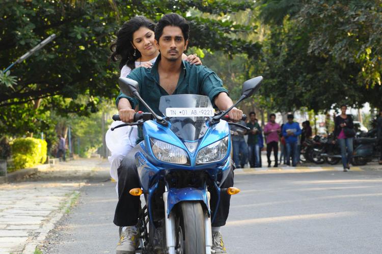 Siddharth And Ashrita Riding Bike Photo Still From Movie Udhayam NH4