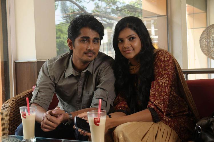 Siddharth And Ashrita Sitting Photo Still From Movie Udhayam NH4