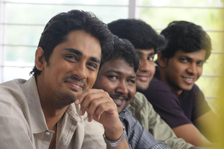 Siddharth With Friends Smiling Photo Still From Movie Udhayam NH4