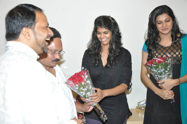 RP Patnaik,Ashritha And Ramesh Smiling Photo Clicked At Udhayam NH4 Movie Audio Launch