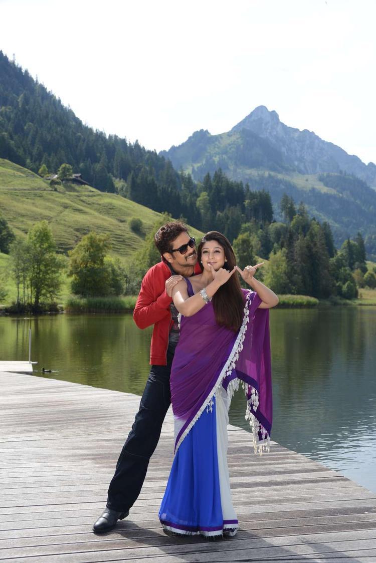 Nagarjuna And Nayantara Cosy Photo Still From Movie Greeku Veerudu