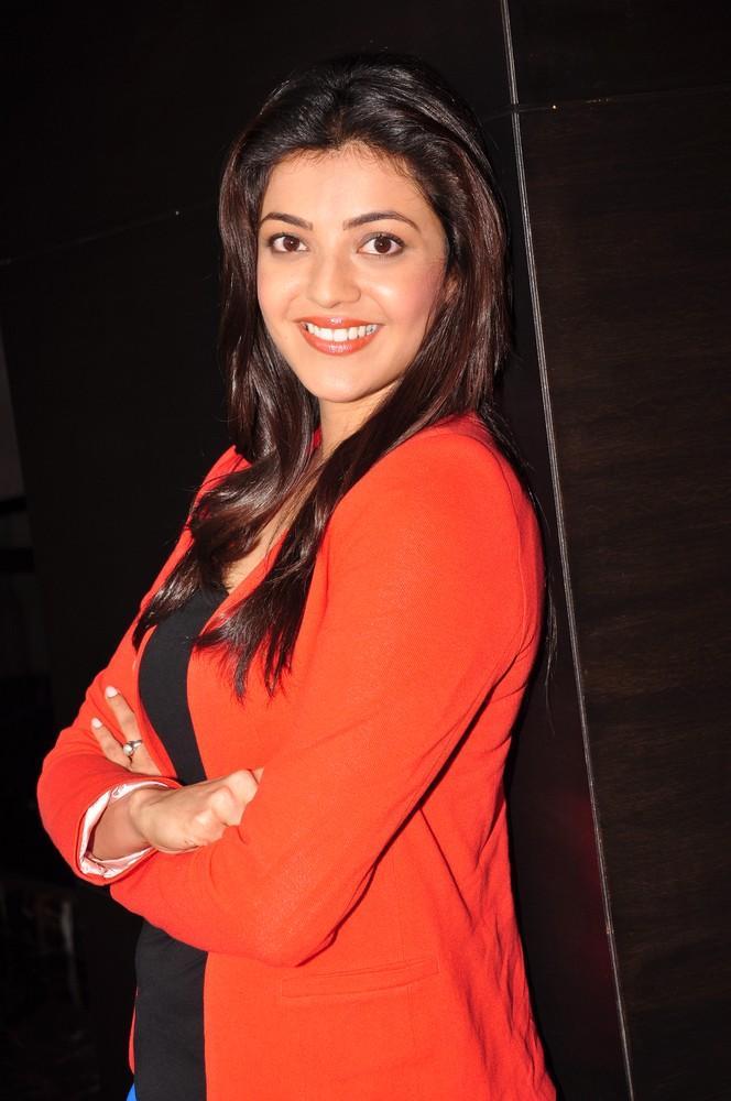Kajal Cute Smiling Photo Still At Baadshah Interview