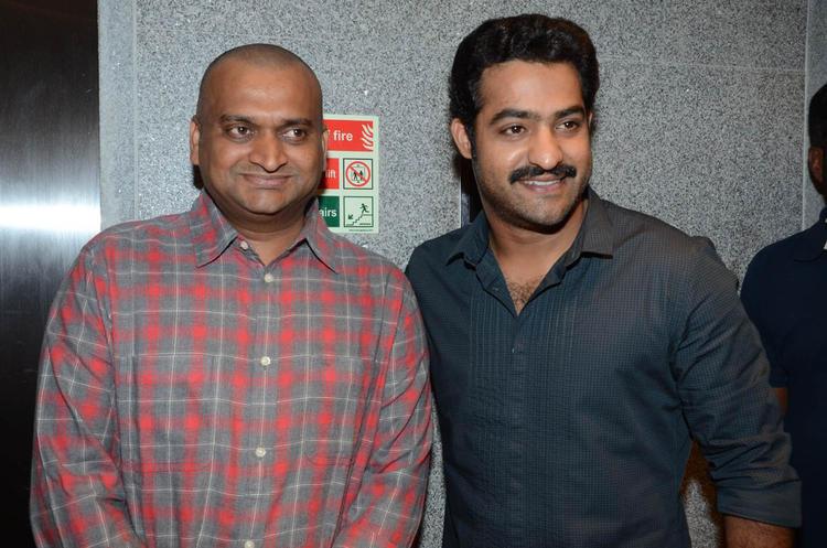 Bandla Ganesh And Jr.NTR Smiling Photo Still At Baadshah Movie Success Meet