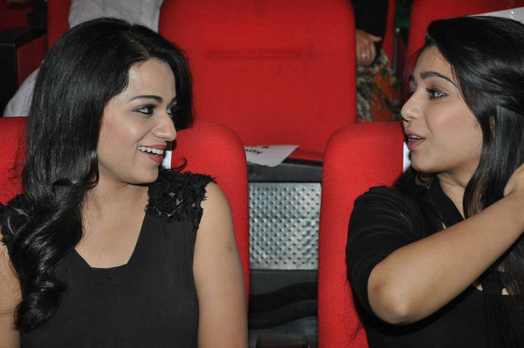 Reshma And Charmy Kaur Chatting Still At Iddarammayilatho Audio Launch Function