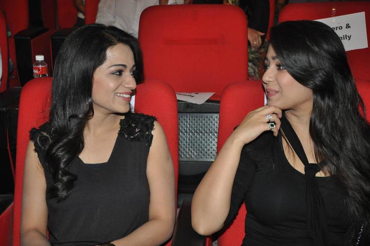Reshma And Charmy Kaur Cool At Iddarammayilatho Audio Launch Function