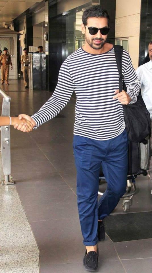 John Abraham Shake hand With A Fan At Airport