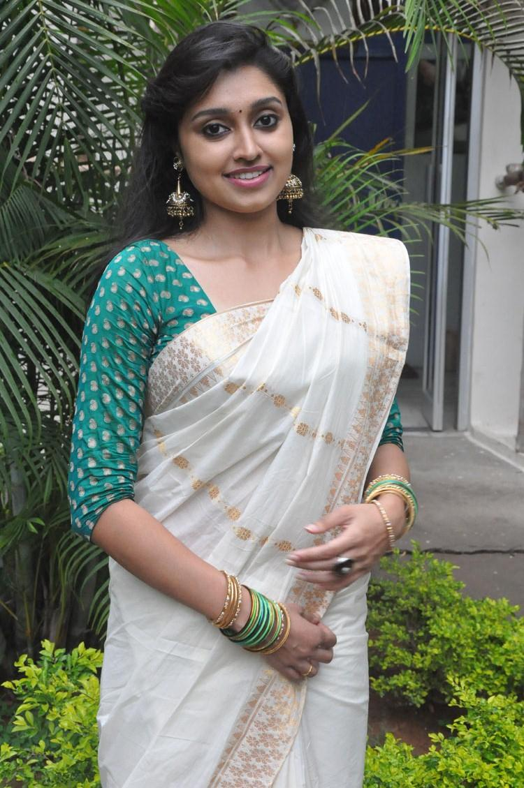 Sija Rose In White Saree With Green Blouse Fashionable Look Still At Ela Cheppanu Movie Audio Release Function