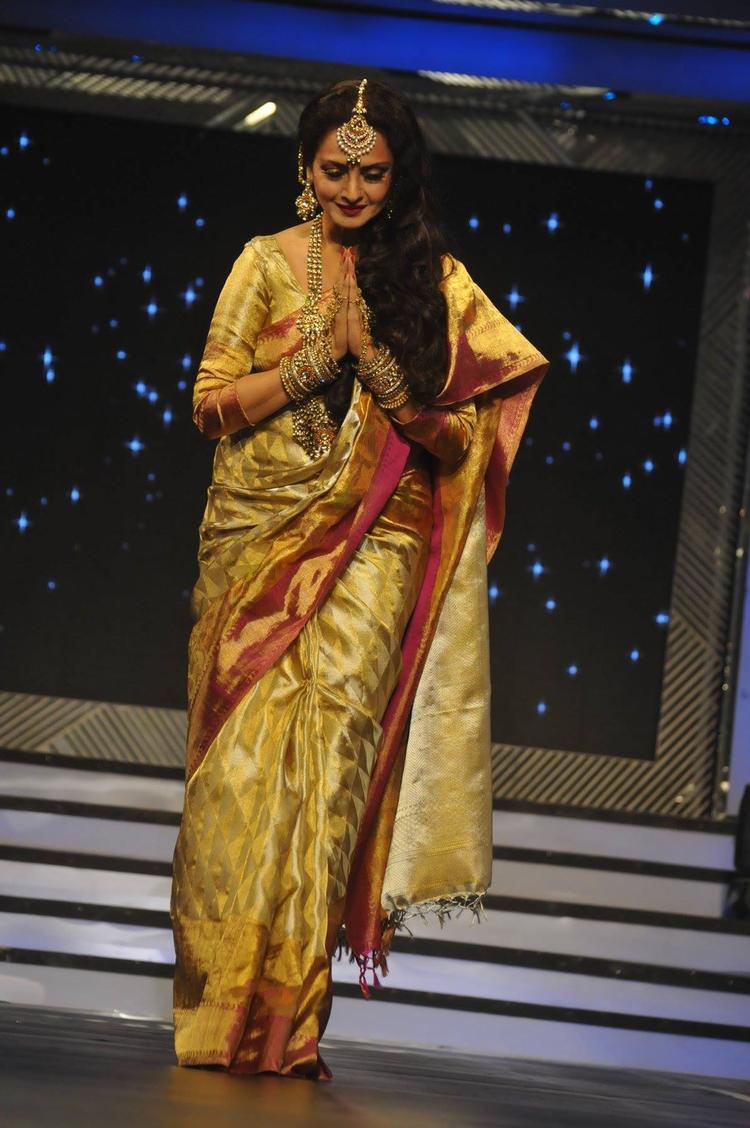 Rekha Greets Public On The Ramp At Yash Chopra's 81st Birth Anniversary Tribute Event