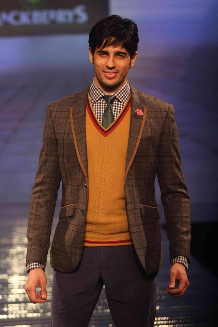 Smiling Sidharth Malhotra Walks On Ramp During The Launch Of Fall-Winter 2013 Collection At Blackberry Sharp Night