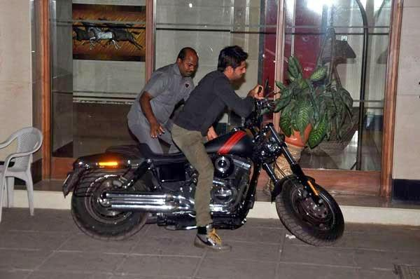 Sidharth Malhotra Snapped On A Bike At Outside Of Karan Johar's House