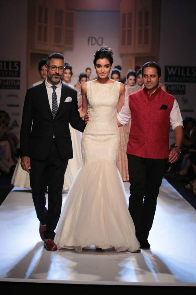 A Model Walks On Ramp With Designers At WLIFW Autumn Winter 2014