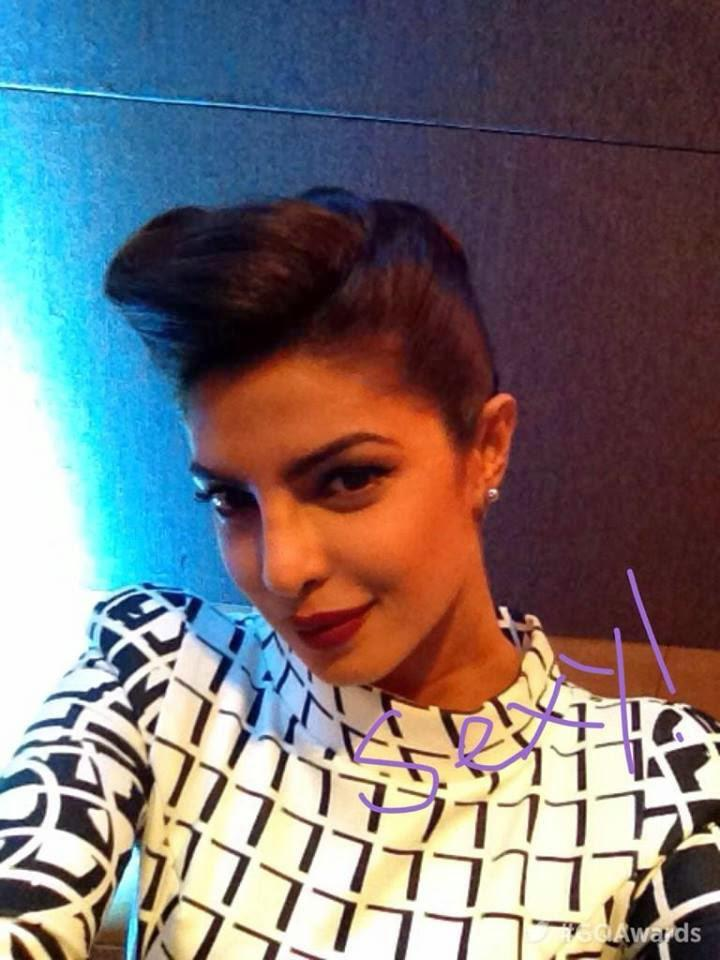 Priyanka Strikes A Cutie Sexy Pose For Shutterbug Of GQ Men Of The Year Awards