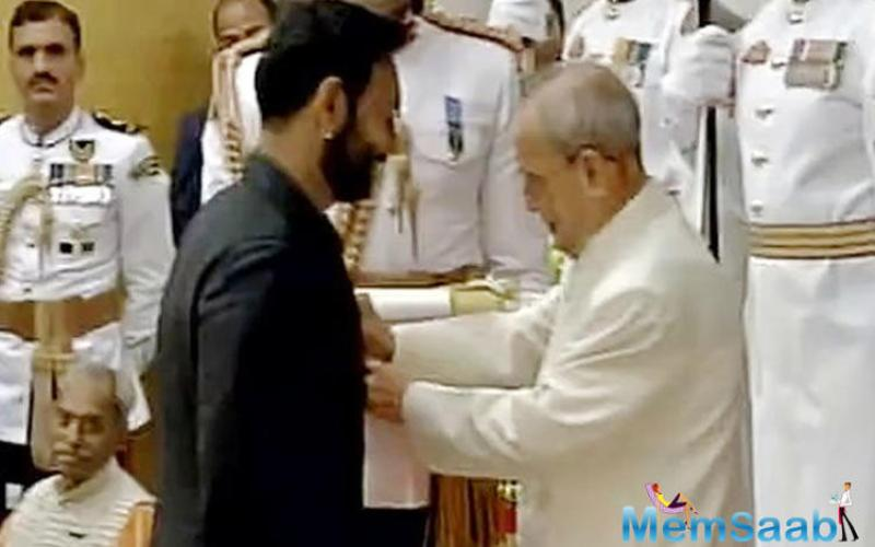Ajay Devgn, in a black bandhgala, received the Padma Shri from President Pranab Mukherjee in a ceremony in New Delhi on Monday.