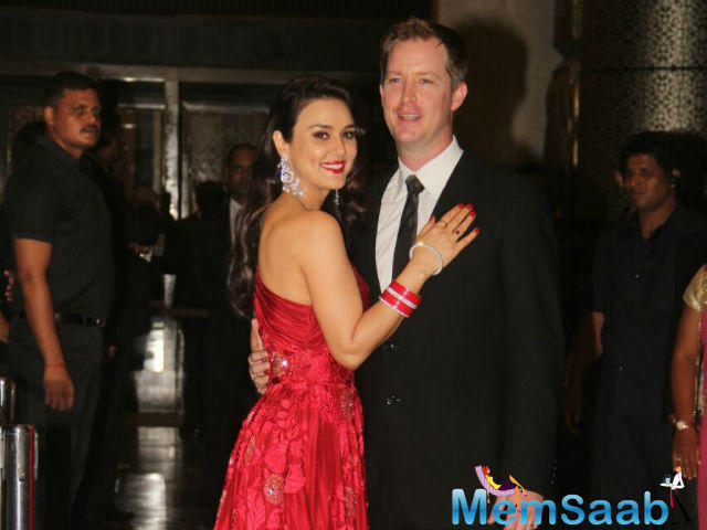 Actress Preity Zinta and her husband Gene Goodenough during their wedding reception in Mumbai, Preity was stunning in a bridal red gown while Gene suited up.