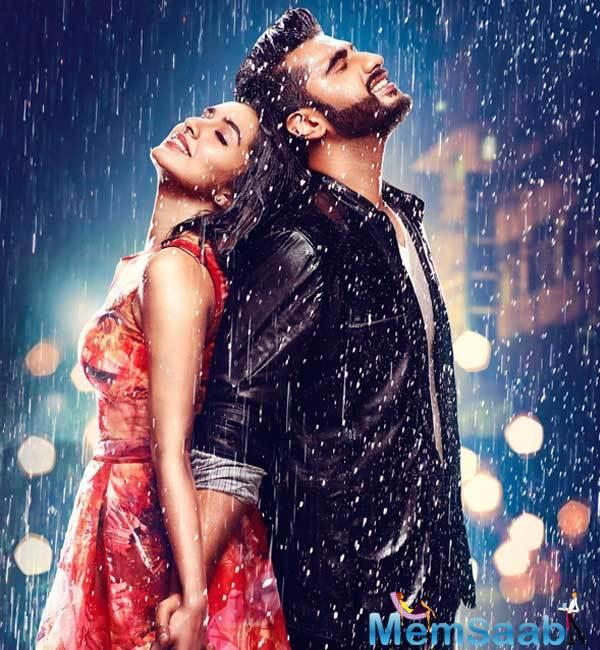 The makers unveiled the look with a motion poster featuring their leading stars smiling in the rain while holding on to each other.