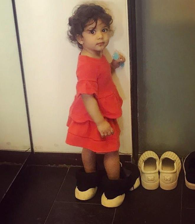 Actor Shahid Kapoor feels his daughter Misha is trying to take away his shoes from him.