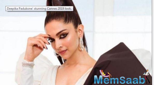 Deepika is wearing custom Dundas couture in the combination of black and cream with an edgy high pony that gives all the drama to the outfit,