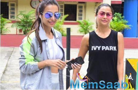Malaika Arora and Amrita Arora Ladak are total gym freaks! Even the stormy weather and spells of heavy showers can't stop them from visiting the gym. On Wednesday, Malaika and Amrita were snapped posing for the shutterbugs.
