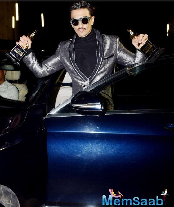 He later made his way to his home with the awards in style.