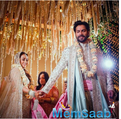 Varun Dhawan and Natasha Dalal got married at The Mansion House, a beach resort, in Alibaug. Post the wedding, the couple posed for the photographers.